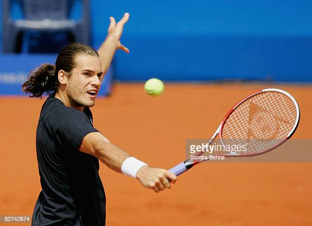 Thomas Haas of Germany returns a shot to Andrei Pavel of Romania during the BMW Open tournament on April 30 2005 in Munich Germany