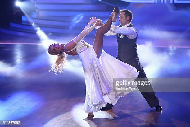 Thomas Haessler and Regina Luca perform on stage during the 1st show of the television competition 'Let's Dance' on March 11 2016 in Cologne Germany