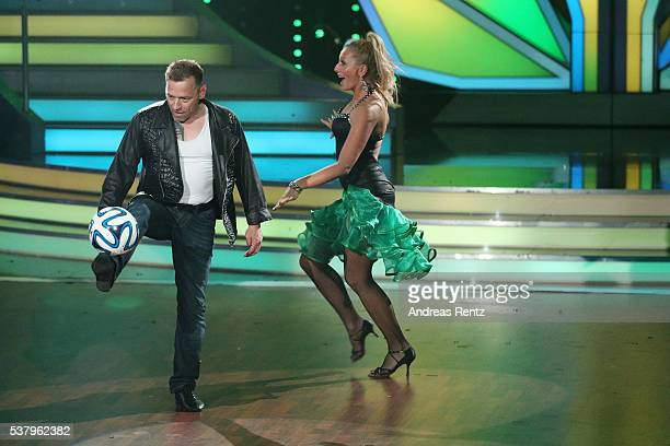 Thomas Haessler and Regina Luca perform on stage during the final show of the television competition 'Let's Dance' on June 3 2016 in Cologne Germany