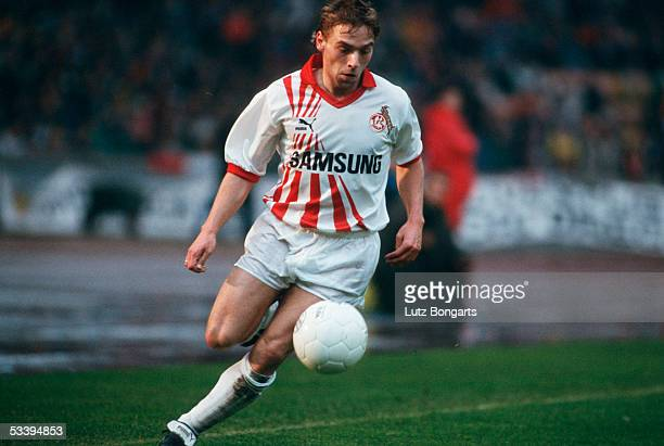 Thomas Haessler of FC Cologne running with the ball during a Bundesliga match on April 1, 1990 in Cologne.