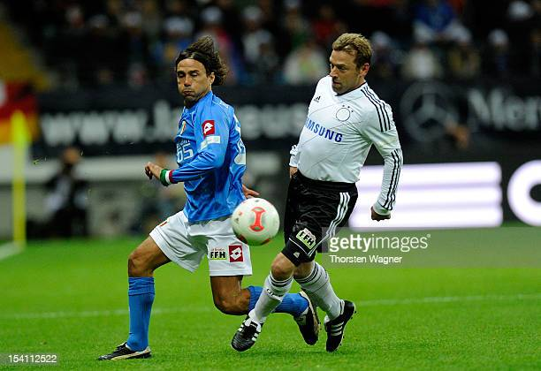 Thomas Haessler of Germany battles for the ball with Antonio Benarrivo of Italy during the century match between Germany and Italy at Commerzbank...