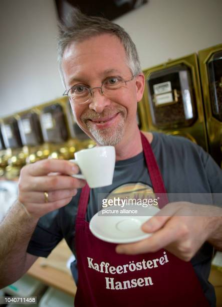 Thomas Hansen drinks a cup of espresso at the Hansen Coffee Rosters inRoedermarkGermany 25 April 2013 Coffee is roasted more slowly than in the...
