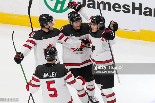 Thomas Harley, Dawson Mercer, Ryan Suzuki and Jordan Spence of Canada celebrate a goal against Slovakia during the 2021 IIHF World Junior...