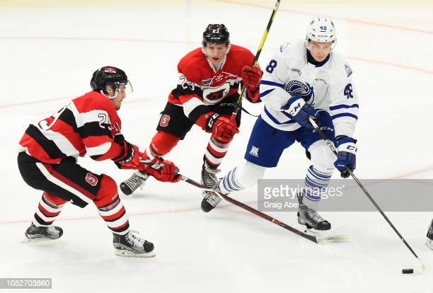 Thomas Harley of the Mississauga Steelheads battles for the puck against Marco Rossi and Tye Felhaber of the Ottawa 67s during OHL game action on...