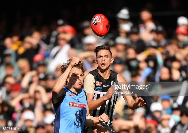 Thomas Harms of Sturt competes for the ball with Aidyn Johnson of the Magpies during the SANFL Grand Final match between Port Adelaide and Sturt at...
