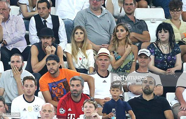 Thomas Hayo Cathy Fischer Hummels wife of Mats Hummels AnnKathrin Brommel wife of Mario Goetze attend the UEFA Euro 2016 semifinal match between...