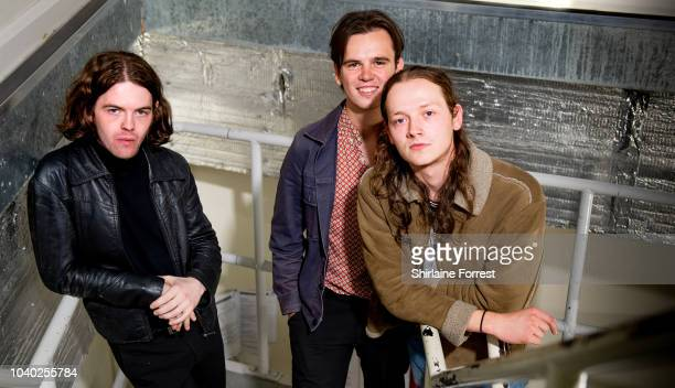 Thomas Haywood Charlie McGough and Matt Neale of The Blinders pose backstage after performing live and signing copies of their album 'Columbia' at...