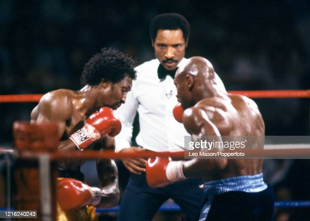 Thomas Hearns of the United States and Marvelous Marvin Hagler in action watched by referee Richard Steele during the WBA, WBC, IBF, The Ring and...