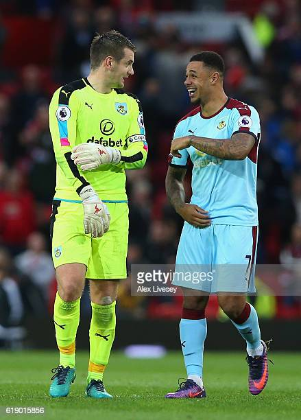 Thomas Heaton and Andre Gray of Burnley celebrate their team's scoreless draw in the Premier League match between Manchester United and Burnley at...