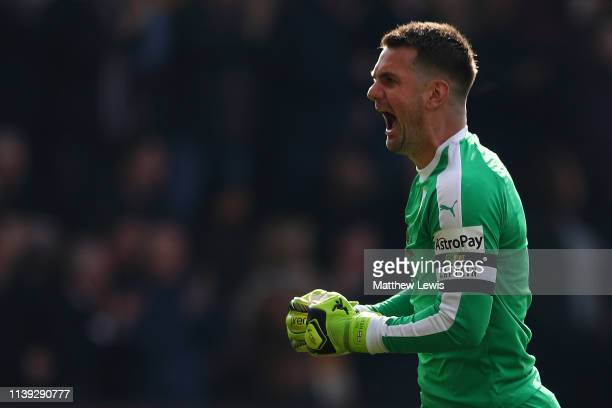 Thomas Heaton of Burnley celebrates after his team's first goal during the Premier League match between Burnley FC and Wolverhampton Wanderers at...