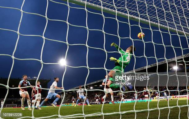Thomas Heaton of Burnley dives to a make save during the Premier League match between Burnley FC and West Ham United at Turf Moor on December 29 2018...