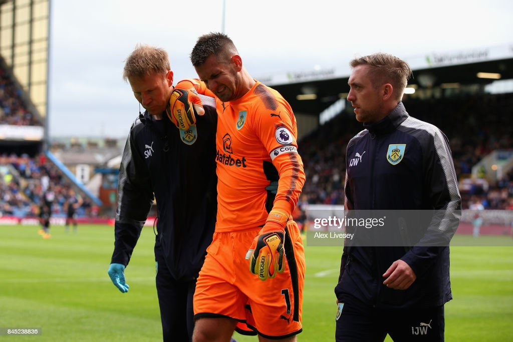 Thomas Heaton of Burnley leaves the pitch following an injury during the Premier League match between Burnley and Crystal Palace at Turf Moor on September 10, 2017 in Burnley, England.