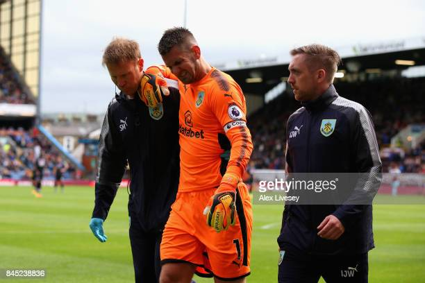 Thomas Heaton of Burnley leaves the pitch following an injury during the Premier League match between Burnley and Crystal Palace at Turf Moor on...