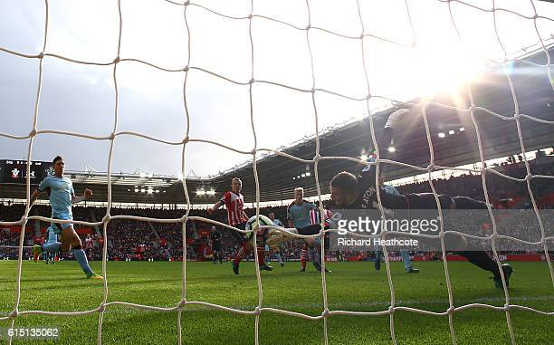 Thomas Heaton of Burnley saves a shot from Charlie Austin of Southampton during the Premier League match between Southampton and Burnley at St Mary's...