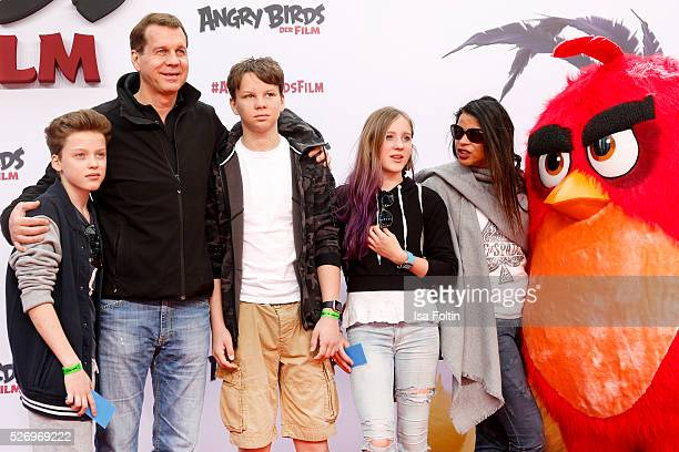 Thomas Heinze his kids Sam the twins Lucille and Lannon and his wife Jackie Brown attend the Berlin premiere of the film 'Angry Birds Der Film' at...