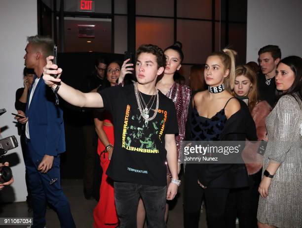 Thomas Henry Jr Maya Henry and guests attend the Republic Records PreGrammy Party at Cadillac House on January 26 2018 in New York City