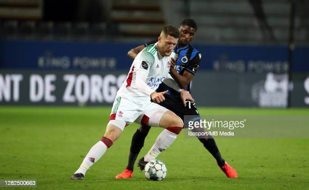Thomas Henry of OHL battles for the ball with Clinton Mata of Club Brugge during the Jupiler Pro League match between OHL and Club Brugge at Stadium...