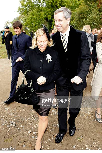 Thomas Hermanns plus guest and his husband Wolfgang Macht leave the church wedding of Barbara Schoeneberger and Maximilian von Schierstaedt at the...