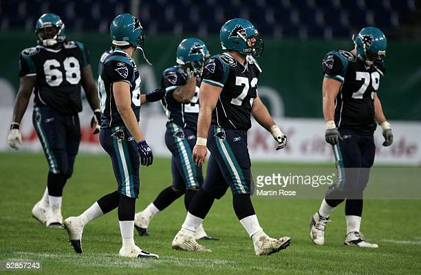 Thomas Herrion Todd France Zack Abron Shawn Lynch Rodney Reed of Hamburg are dejected during the NFL Europe match between Hamburg Sea Devils and...
