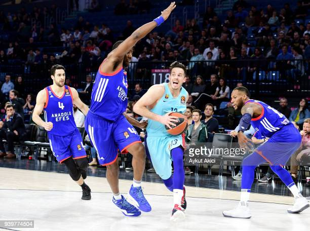 Thomas Heurtel #13 of FC Barcelona Lassa competes with Bryant Dunston #42 of Anadolu Efes Istanbul during the 2017/2018 Turkish Airlines EuroLeague...