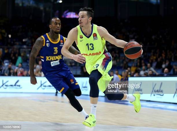 Thomas Heurtel #13 of FC Barcelona Lassa competes with Dee Bost #3 of Khimki Moscow Region in action during the 2018/2019 Turkish Airlines EuroLeague...