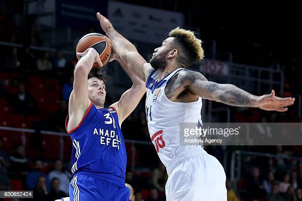 Thomas Heurtel of Anadolu Efes Istanbul is in action against Jeffery Taylor of Real Madrid during the Turkish Airlines Euroleague Basketball 15th...