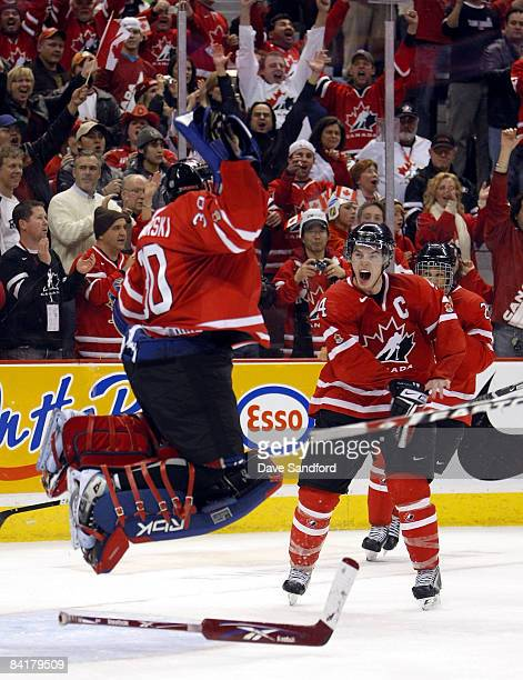 Thomas Hickey of Team Canada celebrates with teammate Dustin Tokarski as the horn sounds to defeat Team Sweden during the 2009 IIHF World Junior...