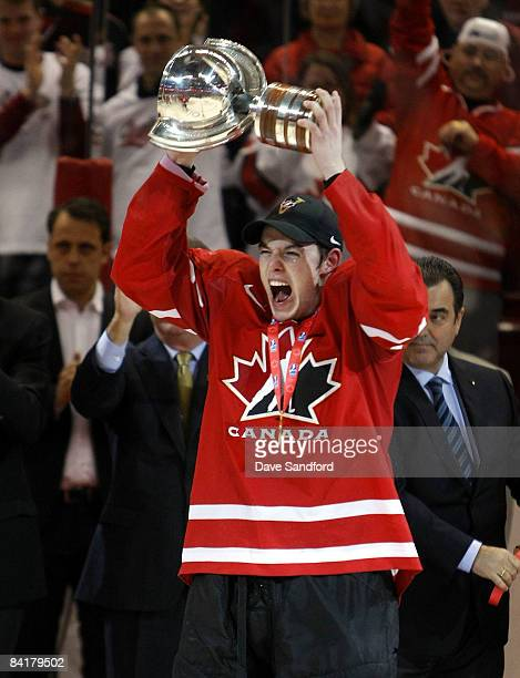 Thomas Hickey of Team Canada hoists the World Junior Championship Trophy after defeating Team Sweden during the 2009 IIHF World Junior Championships...