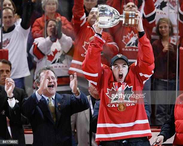 Thomas Hickey of Team Canada raises the Gold Medal Cup during post game ceremonies after defeating Team Sweden at the Gold Medal Game of the IIHF...