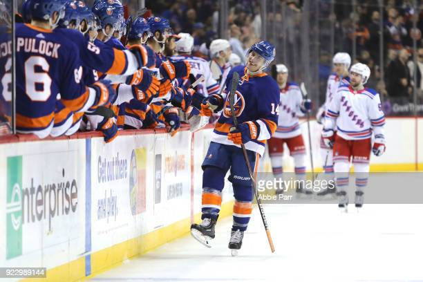 Thomas Hickey of the New York Islanders celebrates with teammates after scoring a goal against the New York Rangers during their game at Barclays...