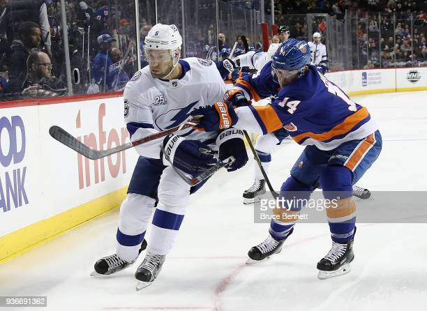Thomas Hickey of the New York Islanders checks Dan Girardi of the Tampa Bay Lightning during the first period at the Barclays Center on March 22 2018...