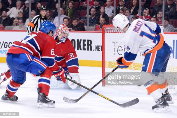 Thomas Hickey of the New York Islanders scores the gamewinning goal on Carey Price of the Montreal Canadiens during the overtime period of their NHL...