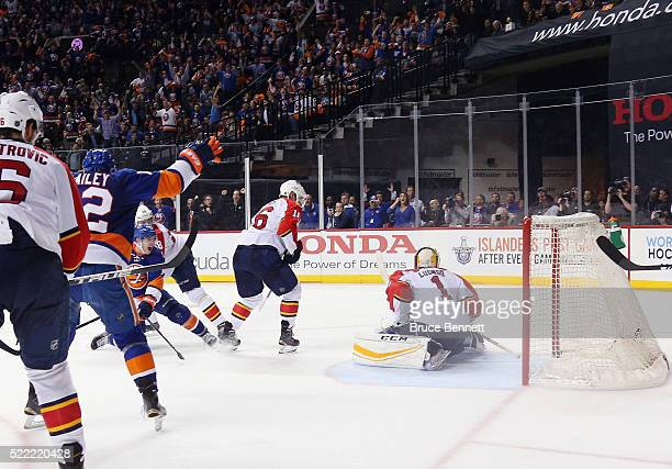 Thomas Hickey of the New York Islanders scores the gamewinning goal against the Florida Panthers during Game Three of the Eastern Conference...