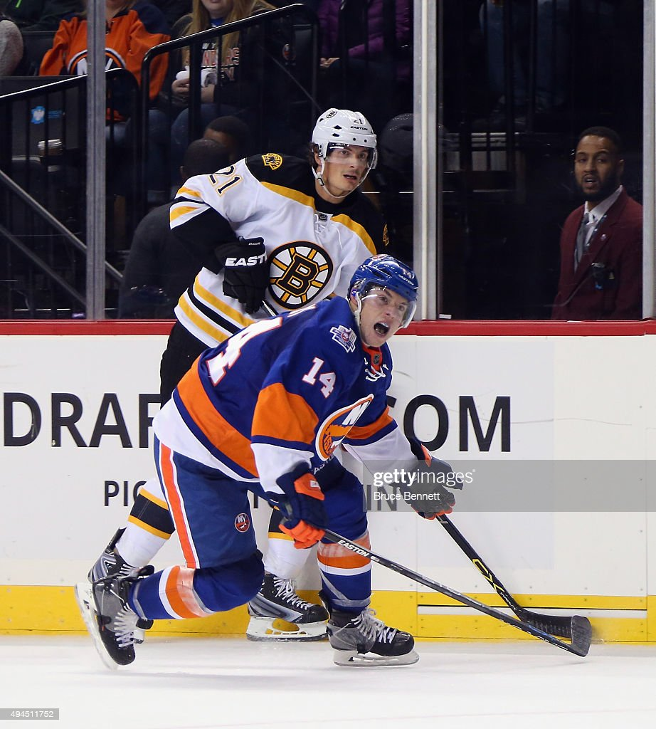 Thomas Hickey #14 of the New York Islanders skates against the Boston Bruins at the Barclays Center on October 23, 2015 in the Brooklyn borough of New York City.