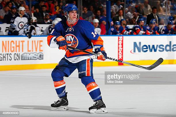 Thomas Hickey of the New York Islanders skates against the Winnipeg Jets at Nassau Veterans Memorial Coliseum on October 28, 2014 in Uniondale, New...