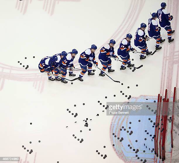 Thomas Hickey of the New York Islanders skates in warmups prior to the game against Buffalo Sabres at the Nassau Veterans Memorial Coliseum on April...