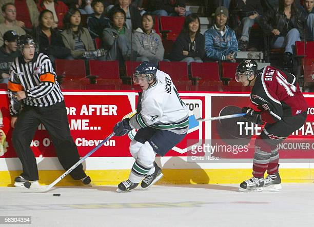 Thomas Hickey of the Seattle Thunderbirds skates past Mitch Bartley of the Vancouver Giants during the WHL hockey game on October 2 2005 at Pacific...