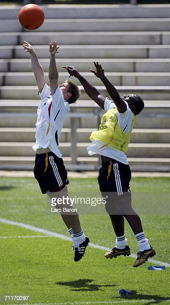 Thomas Hitzlsperger and Gerald Asamoah in action during a German National Football Team training session on June 10 2006 in Berlin Germany
