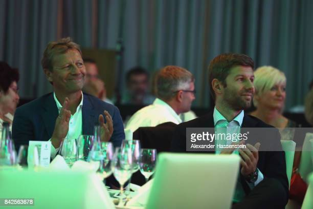 Thomas Hitzlsperger attends with Guido Buchwald the Awarding Ceremony at the 20th anniversary of Volunteering for the Club 100 at MercedesBenz Museum...