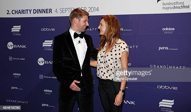 Thomas Hitzlsperger former international football player of Germany and Katrin Bauerfeind pose during the charity dinner of the Magnus Hirschfeld...