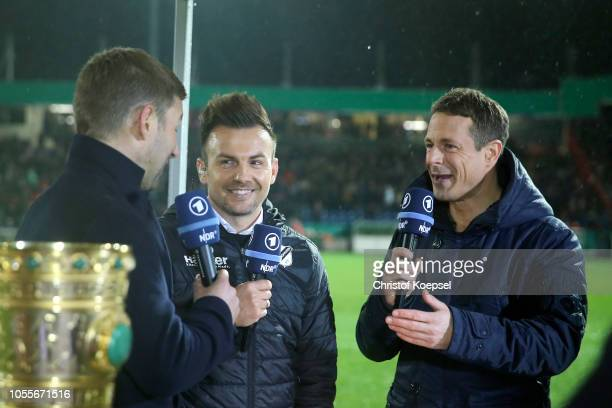 Thomas Hitzlsperger head coach Enrico Maassen of Alexander Bommes of ARD talk prior to the DFB Cup match between SV Rodinghausen and FC Bayern Munich...