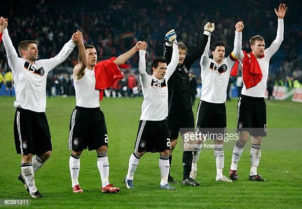 Thomas Hitzlsperger Lukas Podolski Piotr Trochowski Jens Lehmann Michael Ballack and Per Mertesascker of Germany celebrate the winning 40 the...