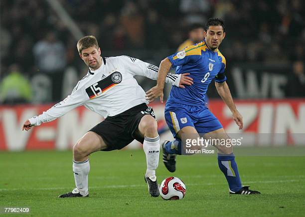 Thomas Hitzlsperger of Germany and Ioannis Ollas of Cyprus fight fir the ball during the Euro 2008 Group D qualifying match between Germany and...
