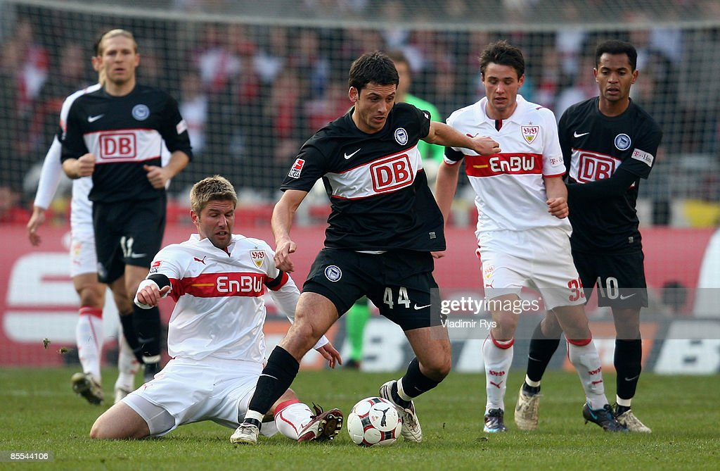 Thomas Hitzlsperger of Stuttgart (L) and Gojko Kacar of Berlin battle for the ball during the Bundesliga match between VfB Stuttgart and Hertha BSC Berlin at the Mercedes-Benz Arena on March 21, 2009 in Stuttgart, Germany.