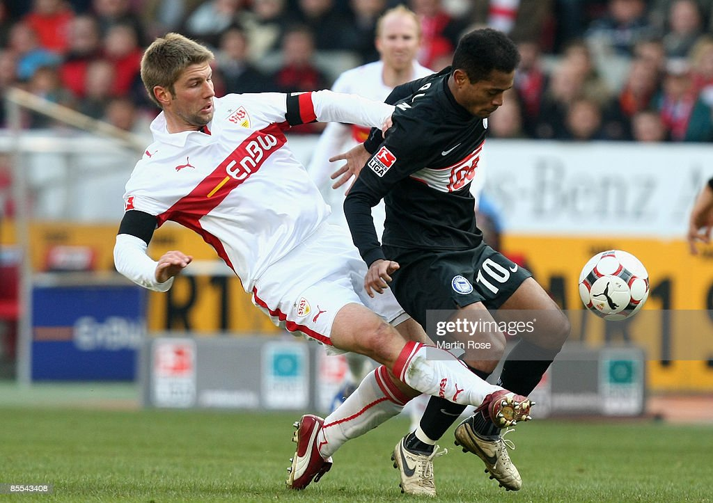 Thomas Hitzlsperger (L) of Stuttgart and Raffael (R) of Berlin battle for the ball during the Bundesliga match between VfB Stuttgart and Hertha BSC Berlin at the Mercedes-Benz Arena on March 21, 2009 in Stuttgart, Germany.