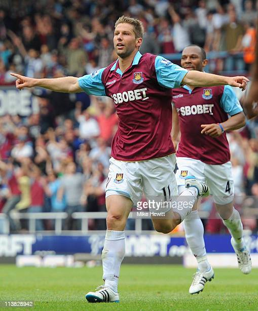 Thomas Hitzlsperger of West Ham United celebrates scoring the equalising goal during the Barclays Premier League match between West Ham United and...