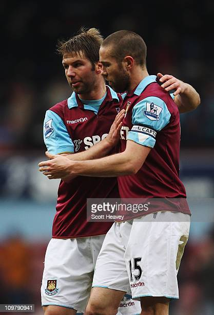 Thomas Hitzlsperger of West Ham United celebrates with team mate Matthew Upson after the Barclays Premier League match between West Ham United and...