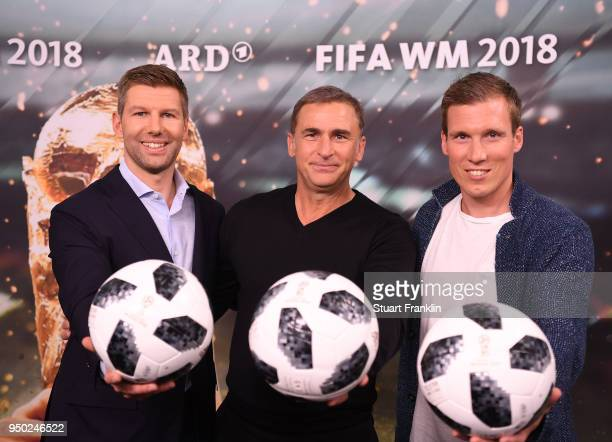 Thomas Hitzlsperger, Stefan Kuntz and Hannes Wolf pose for a picture during the ARD and ZDF FIFA World Cup presenter team presentation on April 23,...