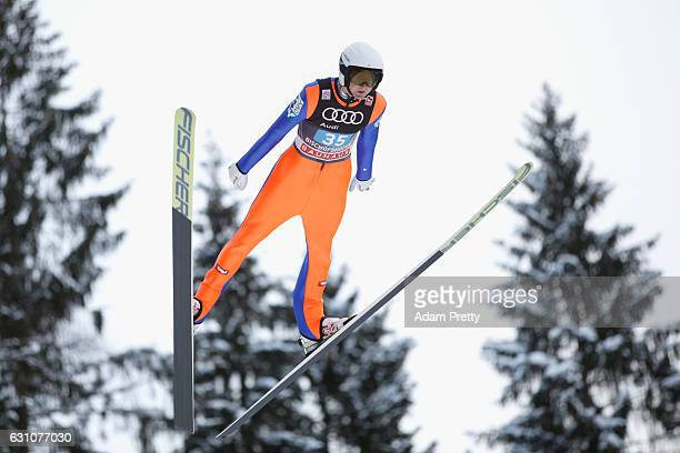 Thomas Hofer of Austria competes at the trail round on Day 2 of the 65th Four Hills Tournament ski jumping event at PaulAusserleitnerSchanze on...