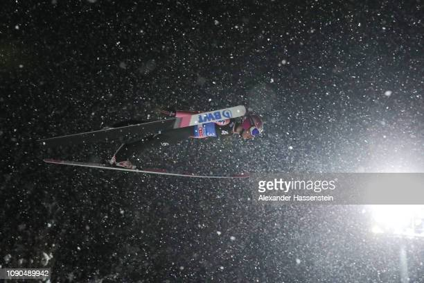 Thomas Hofer of Austria competes during the first round on day 8 of the 67th FIS Nordic World Cup Four Hills Tournament ski jumping event at...